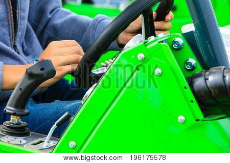 Agriculture equipment agribusiness machinery and vehicles concept. Man operating big industrial agricultural machine