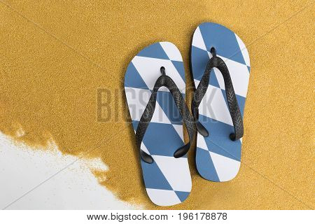 Bavarian thongs on sand for a background