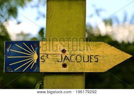 Signpost of the famous walking track santiago de compostela in rural france