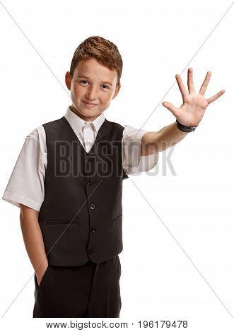 Smiling boy in school uniform showing five fingers