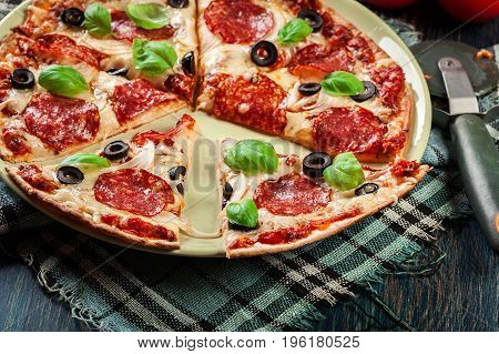 Pizza Pepperoni With Olives Served