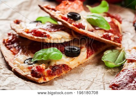 Slices Of Pizza Pepperoni With Olives