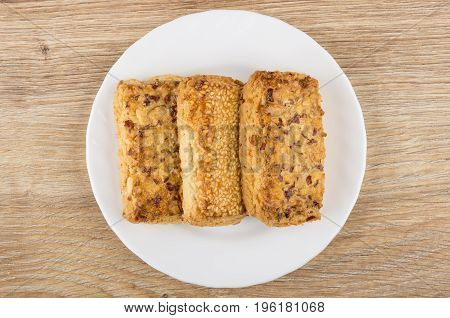 Shortbreads With Nuts And Sesame In White Plate On Table