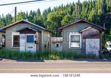 Two Abandoned Shanty Cabins In Mountain Town