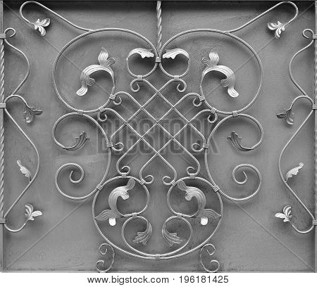 The Texture Of The Silver Metal Gate With A Beautiful Floral Pattern Of Forged Metal