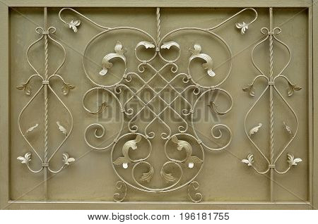 The Texture Of The Golden Metal Gate With A Beautiful Floral Pattern Of Forged Metal