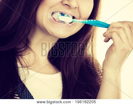 Woman Brushing Cleaning Teeth.
