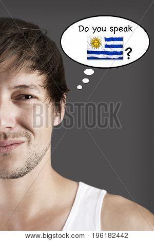 Handsome student thinks do you speak Spanish?
