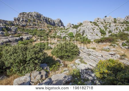 Antequera Spain - July 14 2017: visitors walking by Torcal Natural Park tracks Malaga Spain