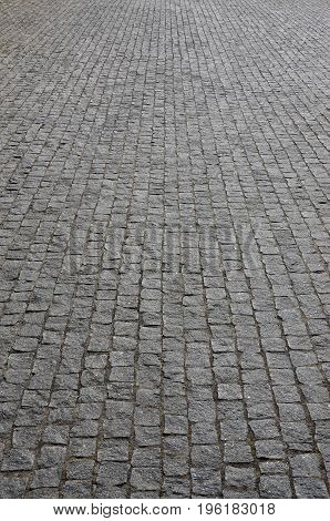 The Texture Of The Paving Slab (paving Stones) Of Many Small Stones Of A Square Shape Under Bright S