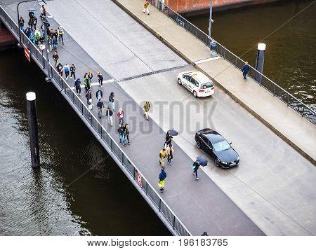 People Crossing Bridge In Hamburg Hdr