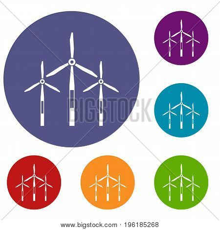 Wind generator turbines icons set in flat circle red, blue and green color for web