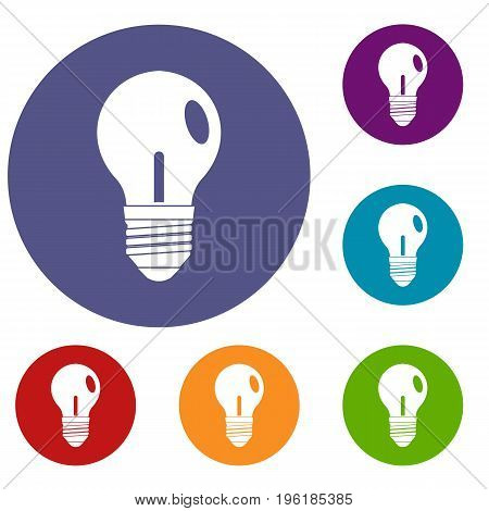 Light bulb icons set in flat circle red, blue and green color for web