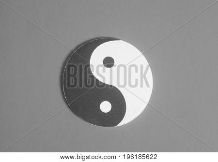 Yin-yang Symbol Made Of Paper On Gray Background.