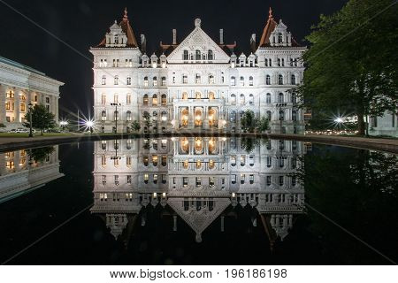 New York State Capitol Building reflection at night from East Capitol Park in Albany. New York