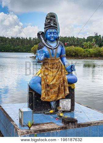 Grand Bassin Mauritius - December 26 2017: The Shiva statue at Ganga Talao (Grand Bassin) Hindu temple Mauritius. It's a copy of the Shiva statue of Sursagar Lake in Vadodara Gujarat India.