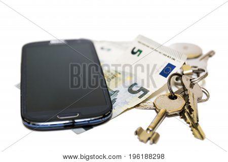 Men's accessories on white background money phone keys
