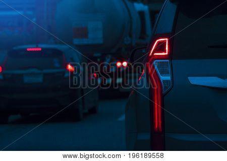 Dark image Car brake for stop on the road. Be prepared for the race or trip to travel on Night time.