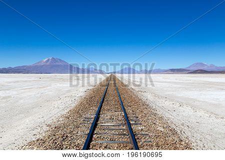 Uyuni, Bolivia - November 02, 2015: Train tracks in the famous salt flat Salar de Uyuni
