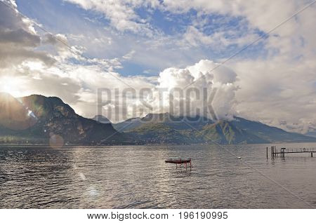 View of Lake Como in a cloudy day with sunshine in Bellagio, a charming tourist village between the lake and the mountains of the Alps. Located in the Lombardy region, northern Italy