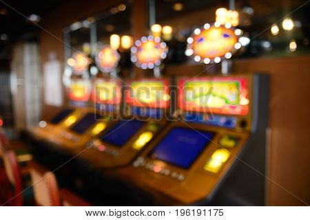 Blurred image of slots machines at the Casino
