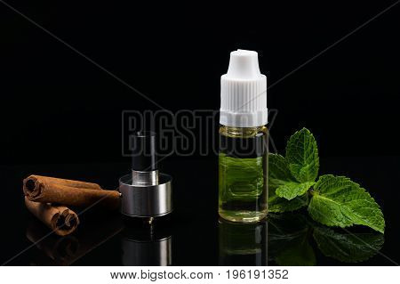 Set for the disclosure of tastes of cinnamon on a black background vaping