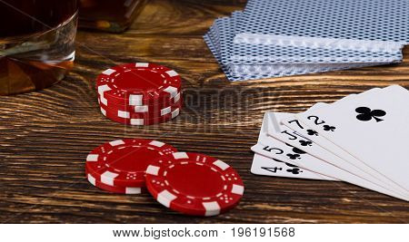 A big win in poker cards on a gambling table