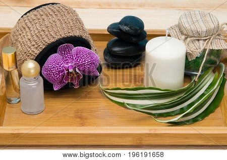 Wooden tray with items for taking a salt bath