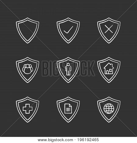 Protection shields chalk icons set. Medical insurance, private documents, property, people, network security. Isolated vector chalkboard illustrations