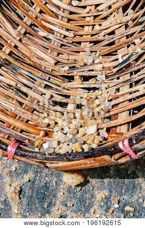Small crude gems in a basket of a gemstone searcher in Sri Lanka