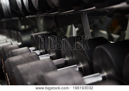 Fitness or body building concept image. Background for advertising of bodybuilding or fitness theme.dumbbells. sport. fitness