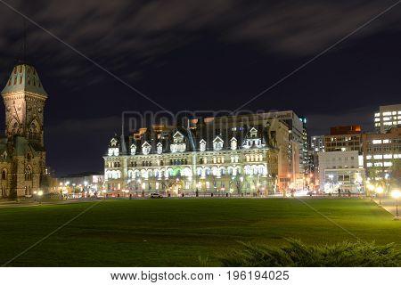 OTTAWA, CANADA - OCT. 30, 2014: Historic Langevin Block in downtown at night Ottawa, Ontario, Canada.