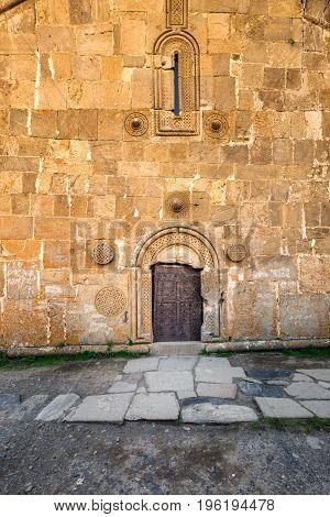 Door entrance to gergeti trinity church or Tsminda Sameba, Georgia.