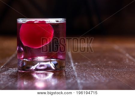 Red Ice Ball In A Drink