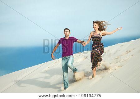 couple running from the mountain. couple on romantic travel honeymoon vacation summer holidays romance.