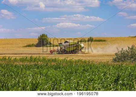Combine harvester in action on wheat field. Palouse harvest season.