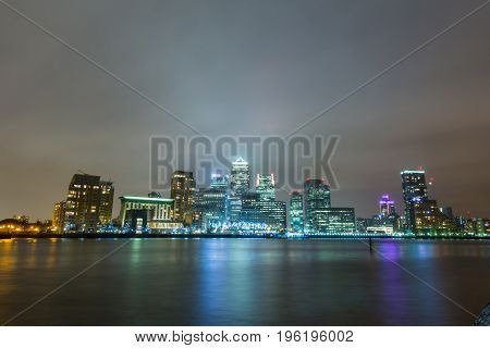 London Skyscrapers And Thames River At Night
