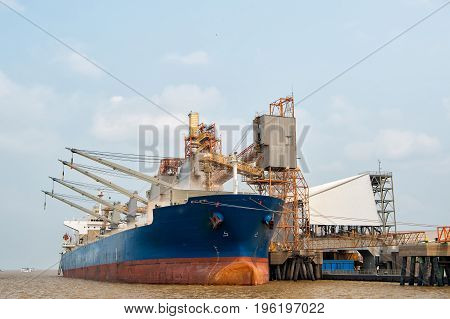 Cargo ship. Logistics and transportation of International Container Cargo ship in the ocean at dock Freight Transportation Shipping