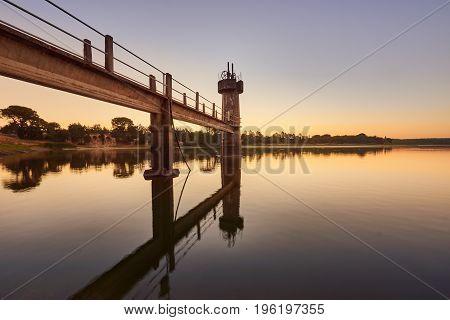 dam intake reflect in water at sunrise