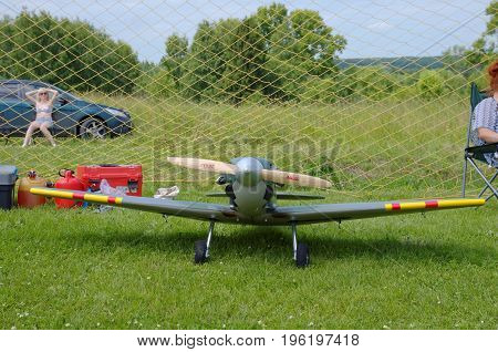 PENZA OBLAST, RUSSIA - JULY 15, 2017: Radio control flying model of Supermarine Spitfire aircraft. The Russian Aeromodelling Cup in Bolshoy Vyas village.
