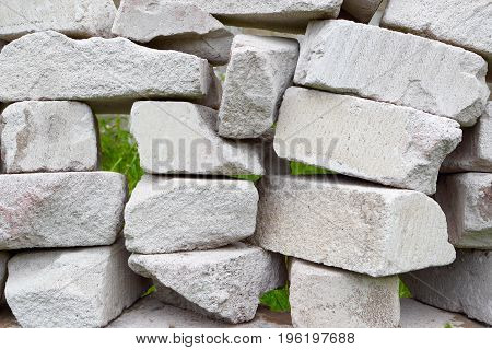 Masonry.Industrial background.Background wall of stone blocks on the site.