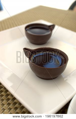 portuguese typical beverage ginginha in chocolate cup