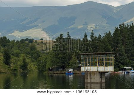 Environment of the dam, reservoir or barrage  Dushantsi at river Topolnitsa, with passenger-ship, Central Balkan mountain, Stara Planina, Bulgaria poster