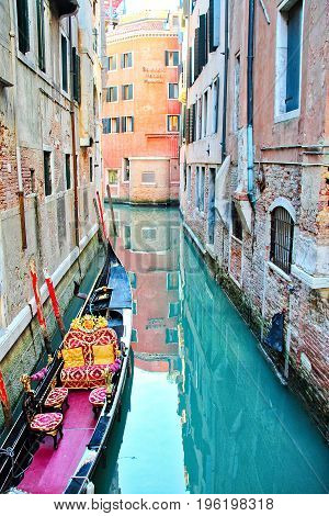 A gondola floating at dock in Venice, Italy.