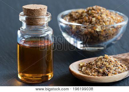 A Bottle Of Myrrh Essential Oil With Myrrh Resin