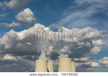 Nuclear power plant Temelin in the Czech Republic. Dusk landscape with big chimneys. Clouds of steam derailing from a nuclear power station tower.