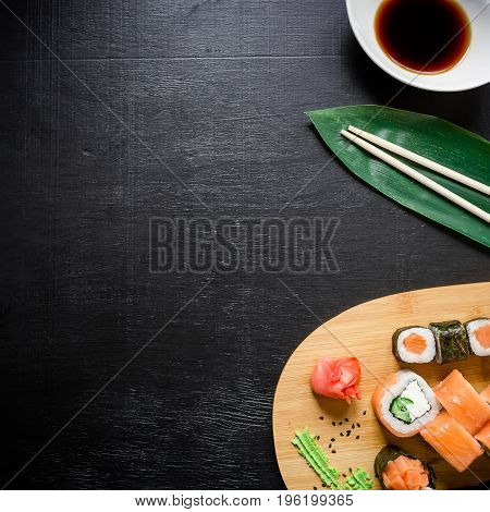 Set of traditional japanese food on a dark background. Asian food frame. Top view. Flat lay