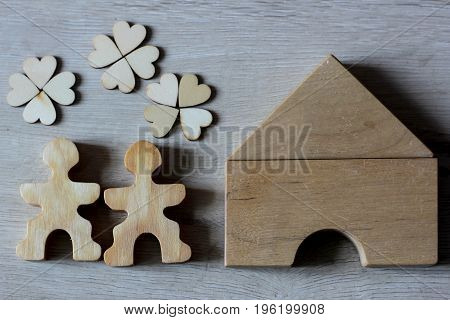 couple dreams about new house wooden figure concept