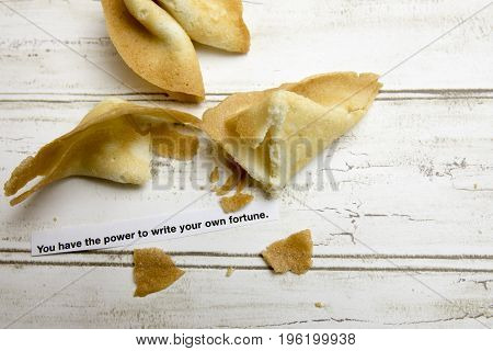 Chinese fortune cookies with inspirational message sheet.