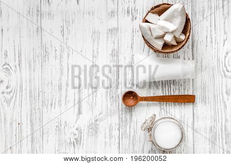 Organic cosmetics with coconut. Coconut on wooden background top view.